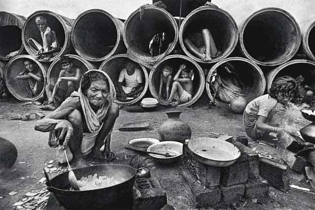 To survive the rain, families took shelter in concrete pipes.