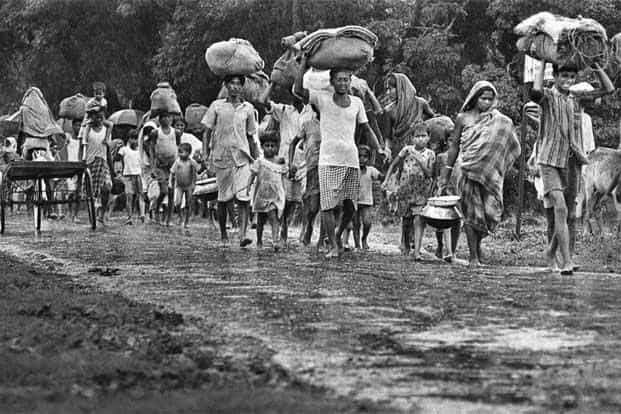 Refugees fleeing with their meagre belongings.