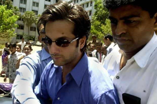 6 May 2001: Actor Fardeen Khan is escorted for remand in Bombay. Khan was arrested under the Narotic Drugs and Psychotropic Substance Act, after being caught buying cocaine from a drug dealer in Mumbai on 5 May 2001. AFP