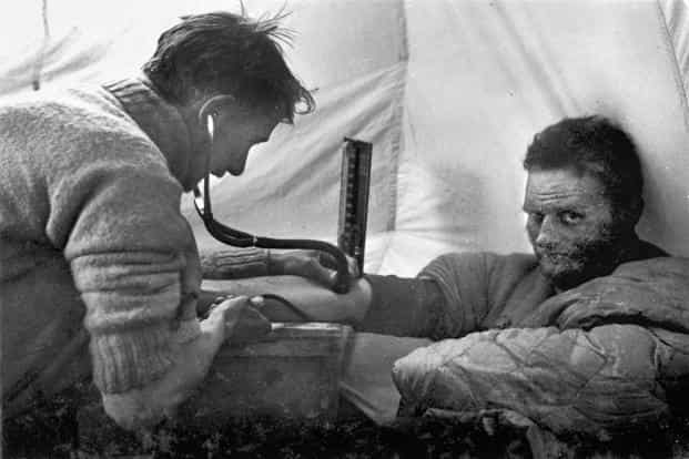 Pioneering British climber and explorer Eric Shipton gets his blood pressure checked during the 1938 Everest expedition. Shipton was involved in Everest expeditions throughout the 1930s.