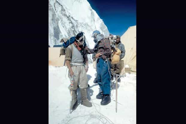Norgay (left) and Hillary check their oxygen equipment during the 1953 expedition.