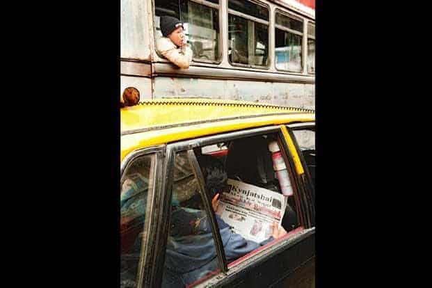 For this man, the newspaper is a companion as he moves through chaotic traffic in Shillong.