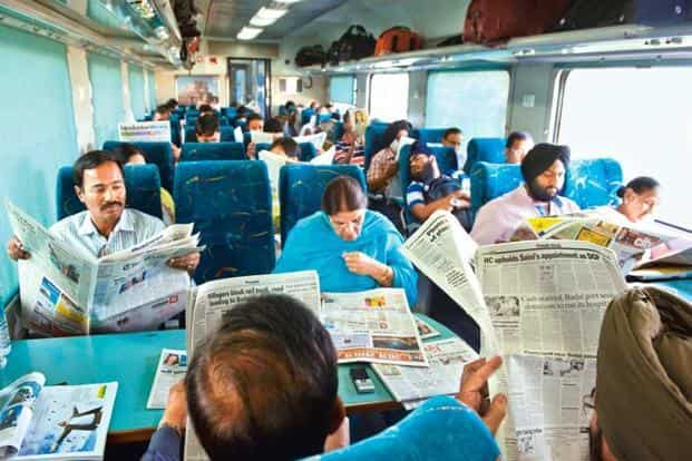 Reading the newspaper seems to be a popular pastime for these passengers on the New Delhi-Kalka Shatabdi.