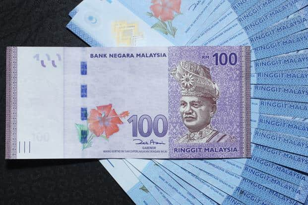 Ringgit Jumps Most Since 2010