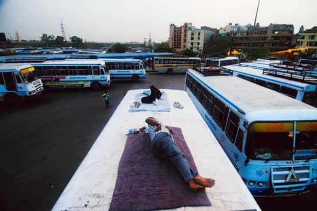Employees get some rest on the roof of a Rajasthan State Road Transport Corporation bus at Sarai Kale Khan