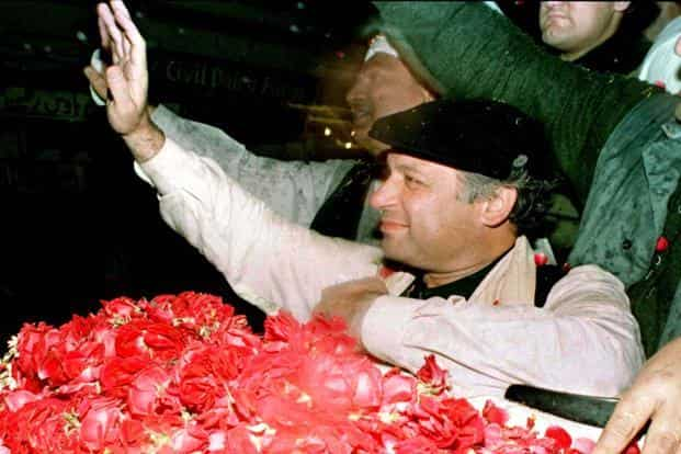 1 February 1993: Nawaz Sharif, leader of the Pakistan Muslim League (PML) party, waves to his supporters in Lahore. His third term as prime minister has come after many challenges including  imprisonment and exile. Reuters