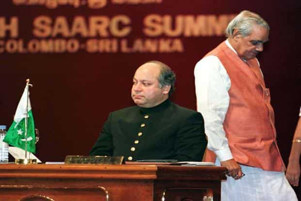 29 July 1998: Indian Prime Minister Atal Behari Vajpayee (R) walks past his Pakistani counterpart Nawaz Sharif during the SAARC summit in Colombo. Sharif's victory has raised hopes of better ties between New Delhi and Islamabad. Reuters