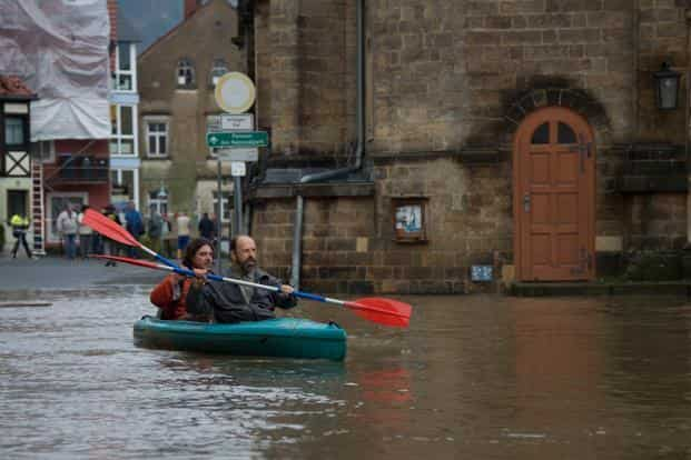 People canoe through the flooded city of Wehlen, Germany. In the old town of Passau in southeast Germany, the water has gushed from three rivers: Danube, Inn and Ilz, pushing water levels to the highest they have been in 70 years. AFP