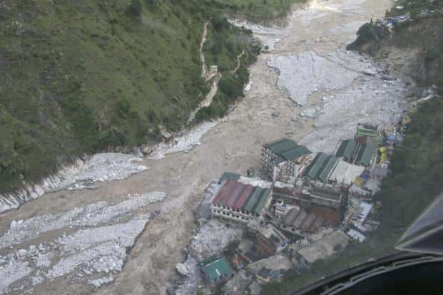 Flood waters flow into a residential complex in Uttarakhand. The massive rains led to landslides and flooding devastating vast swathes of the hill state.  Reuters