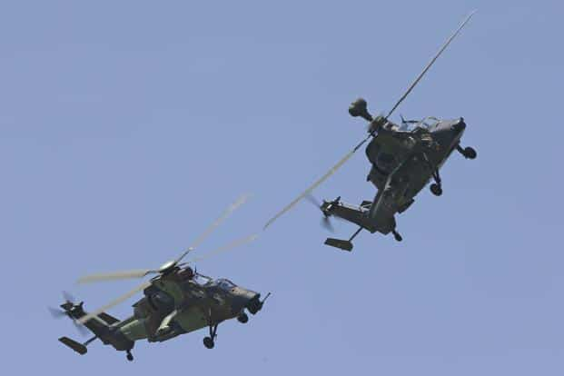 Eurocopter Tiger H61 helicopters display their flying skills at the Le Bourget airport. Reuters