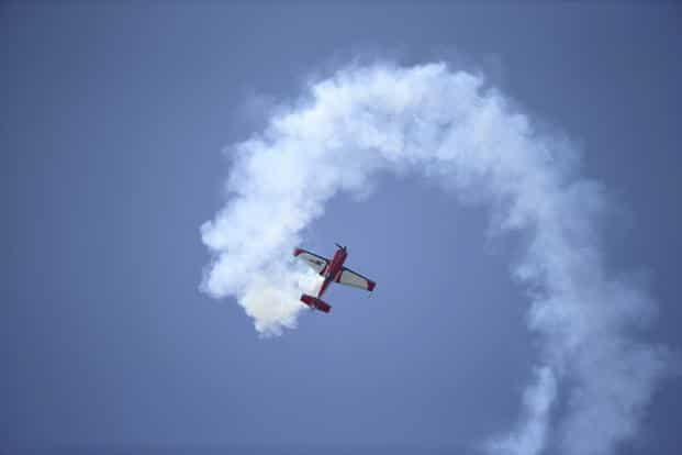 An Extra 330SC, a single-seat aerobatic monoplane made by Extra Aircraft, takes part in a flying display during the air show. Reuters
