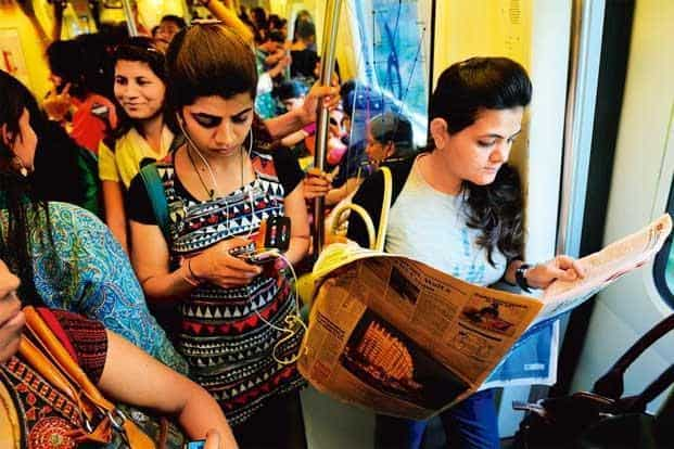 Women read, listen to music and catch up on gossip in the women's compartment. Photographs: Priyanka Parashar/Mint