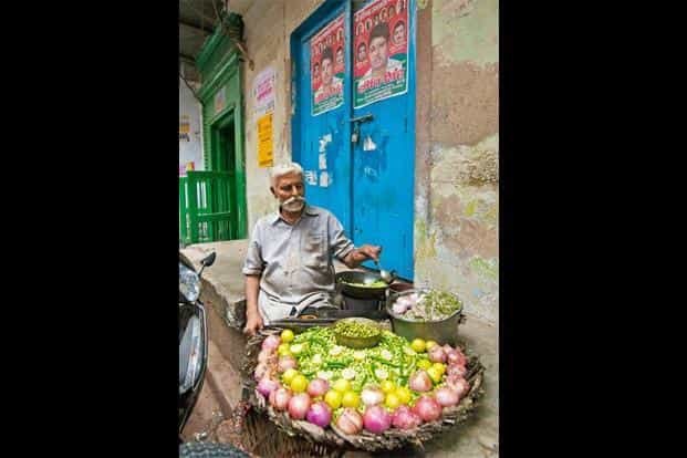 Murari Lal Nigam carries around a hot pan selling roasted fresh peas with sliced onions and green chillies