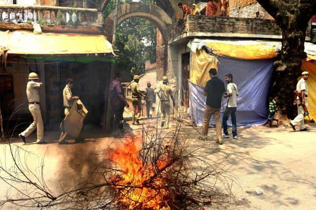 Vishwa Hindu Parishad (VHP) members set branches on fire while demonstrating against the ruling Samajwadi Party (SP) in Ayodhya, Uttar Pradesh. The UP govt on Sunday clamped down on the VHP's padayatra for a Ram Temple. Ramesh Pathania/Mint