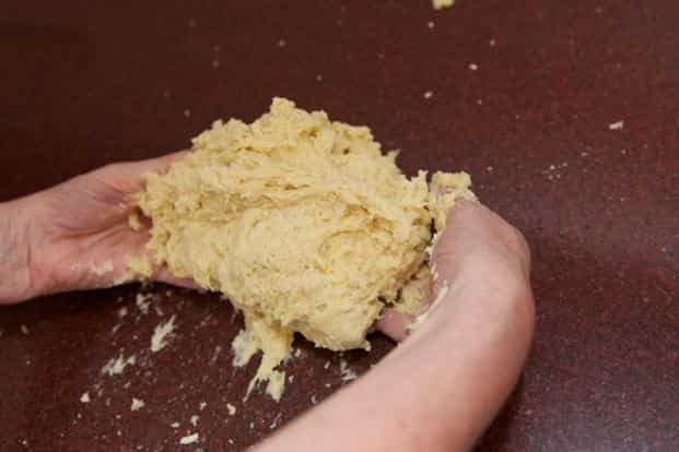 Make a very sticky dough. Tip the dough out onto the work surface (don't put any flour on it).