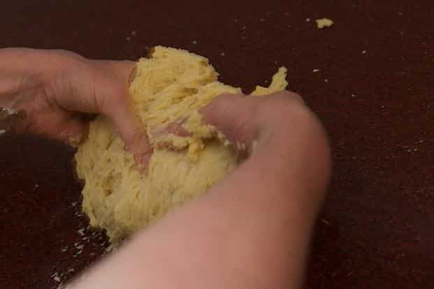 Knead until the dough forms a smooth rounded dough.
