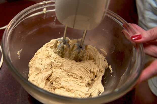 To make the icing, beat together the butter, icing sugar and coffee until you have a smooth, light mixture