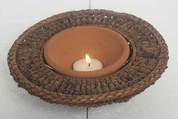 Coco twig bowl with terracotta diya (eco-friendly); The Home of the Traveler, Sultanpur, MG Road, New Delhi; `4,790; www.facebook.com/TheHomeofTheTraveler