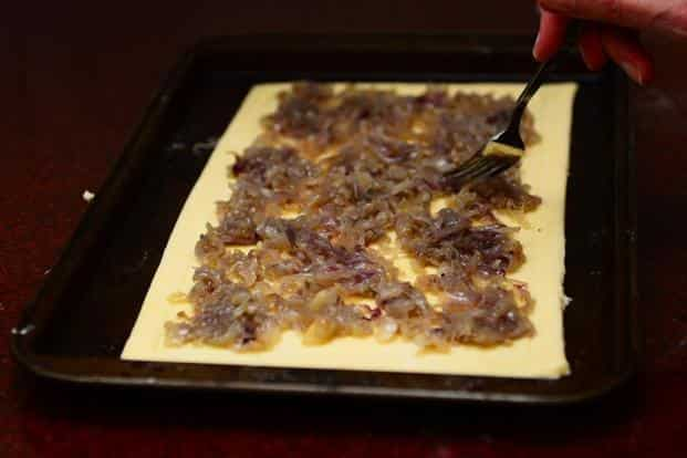 Spread the cooked onions onto the area inside the border.