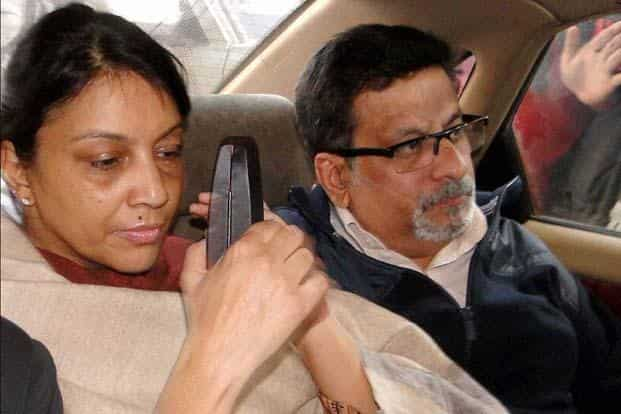 Nupur Talwar and Rajesh Talwar arrive at the special CBI court in Ghaziabad on Monday to hear the verdict in the twin murder case of their daughter Aarushi and domestic help Hemraj. The court sentenced the Talwar couple, guilty of filicide, to life imprisonment. PTI