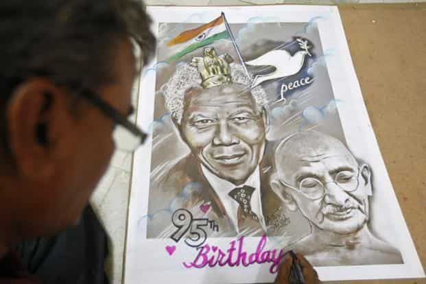 Calling Nelson Mandela the Mahatma Gandhi of our times does no favour to either. Photo: Reuters
