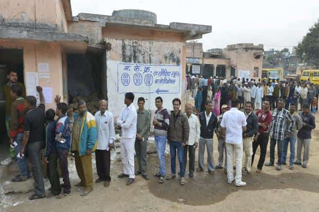 Voters wait in queues to cast votes for the Assembly elections in Bhopal, Madhya Pradesh on 25 November. Madhya Pradesh, this year, recorded its highest ever polling of over 70%. The previous highest turnout was 69.58% in 2008. PTI