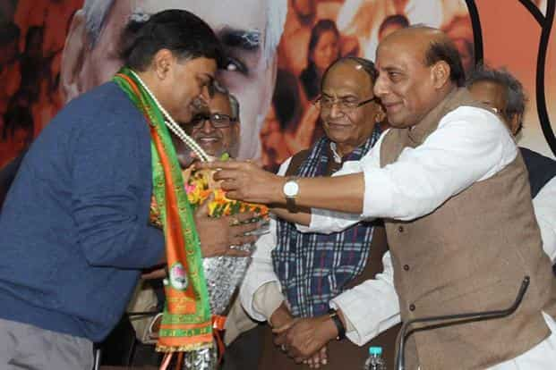 BJP President Rajnath Singh with former home secretary R.K. Singh as the latter joined the party, in New Delhi on Friday. Photo: Manvender Vashist/PTI