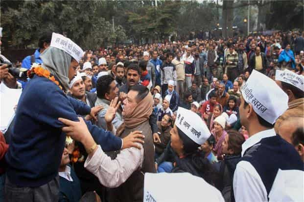 Kejriwal with his suppoters at a Gole Market in New Delhi on 22 December. A former civil servant turned politician, Kejriwal has been under mounting pressure to form a coalition government since his party's stunning performance in the 4 December elections. PTI