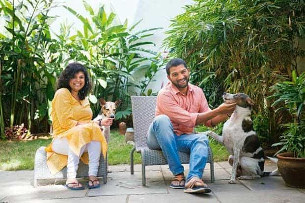 Shobitha Mani and Gautam John with their dogs Ella and Sparky, at their Bangalore home. Photo: