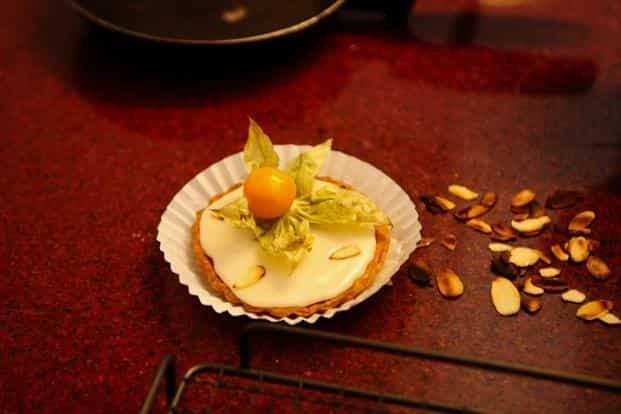 When the tartlets are cool, smooth a spoonful of icing over it.