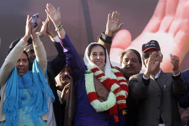 Pakistani former premier Benazir Bhutto waves to her supporters during her last election campaign rally in Rawalpindi on 27 December 2007. Bhutto was assassinated in a bombing on the same day in Rawalpindi. AFP
