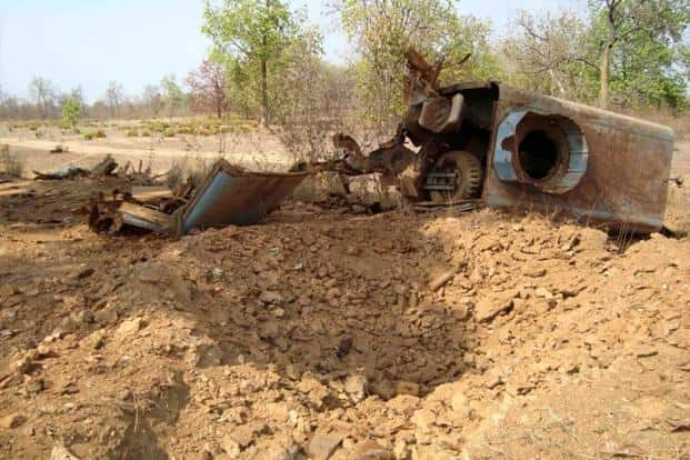 The wreckage of a military vehicle is seen next to a crater caused by an explosion during a Maoist rebel attack in Dantewada on 6 April. Maoist rebels killed 76 paramilitary police in the jungle ambush. AFP