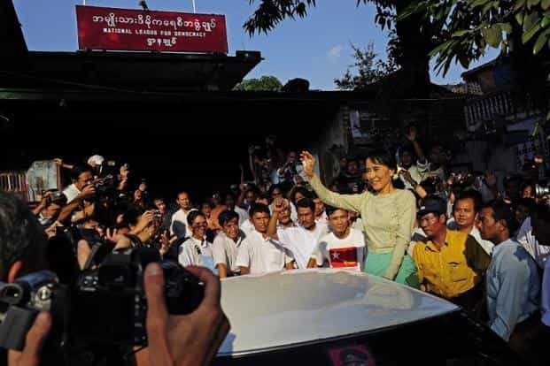 Myanmar's Aung San Suu Kyi waves to supporters as she arrives in Yangon on 13 November after her release following almost 15 years in detention. AFP