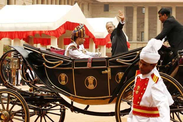 President Pranab Mukherjee, who is sworn in as India's 13th president on 25 July, waves to the media as he arrives at Rashtrapati Bhawan. HT