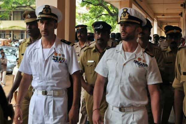 A file photo of Italian marines Latore Massimiliano ( Left) and Salvatore Girone (Right) are escorted by Indian police outside a Kollam court in May 2012. Photo: AFP