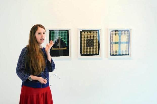 Alyssa Pheobus Mumtaz with her works