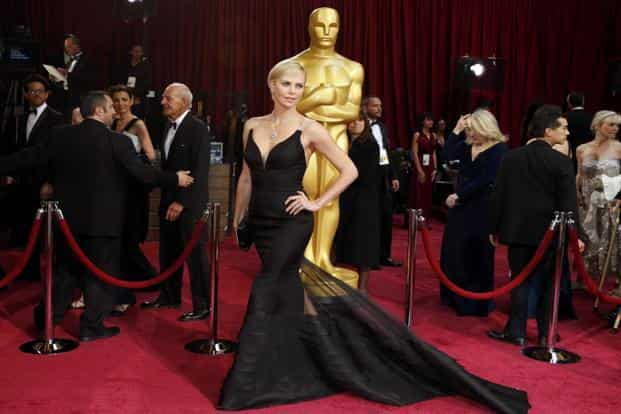 1. Charlize Theron in black Dior couture, Harry Winston jewels. Reuters