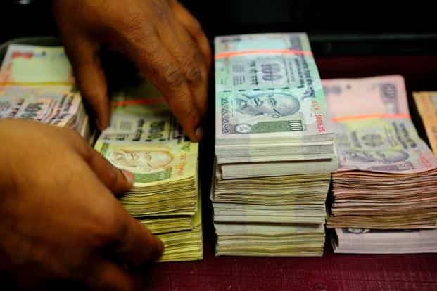 The rupee depreciated 15.8% against the dollar in 2011, 3.5% in 2012 and 11% last year, raising the buying power of the greenback. Photo: Priyanka Parashar