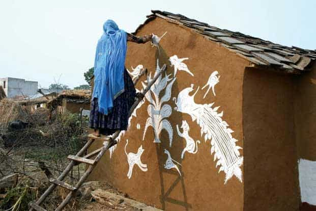Meena women of Rajasthan draw images of nature and nurture—baby animals and birds with their mothers—on the walls of their houses, during harvest season. Photo: Madan Meena