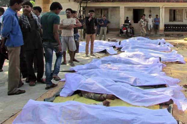 Bodies of paramilitary soldiers killed in the ambush lie on the ground outside a police station in Sukma district, Chhattisgarh on 11 March. Maoist rebels ambushed soldiers in a brazen daytime attack on their camp on Tuesday. AP
