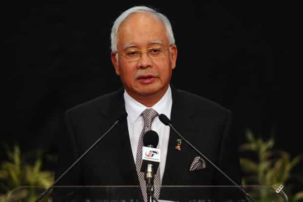 Malaysian Prime Minister Najib Razak speaks during a press conference about MH370, in Kuala Lumpur, Malaysia. Najib said that a new analysis of satellite data indicates the missing Malaysia Airlines plane crashed into a remote corner of the Indian Ocean, AP
