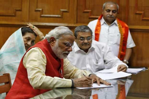 Narendra Modi, prime ministerial candidate for BJP, signs his nomination papers for the general elections in Vadodara, in Gujarat. Photo: Amit Dave/Reuters