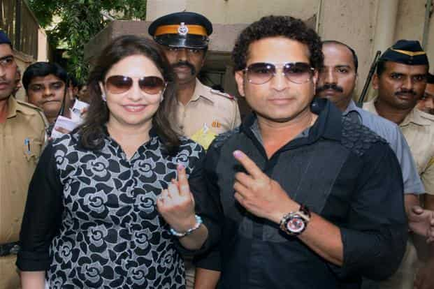 Cricketer Sachin Tendulkar with wife Anjali Tendulkar after casting their vote. PTI