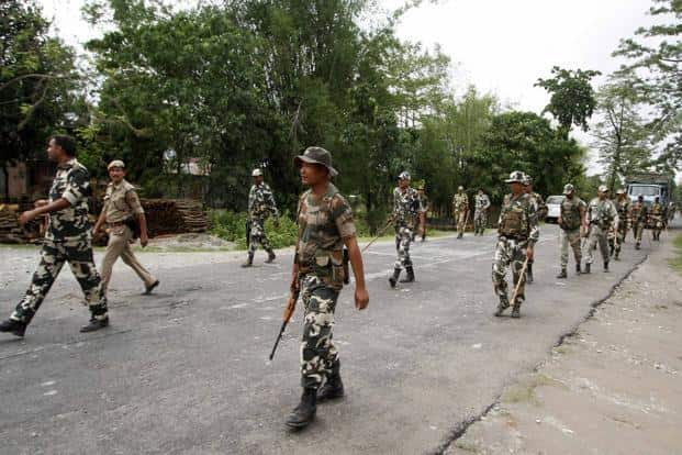 Security personnel patrol during a curfew in Baksa district in the Assam on Sunday. Photo: Reuters
