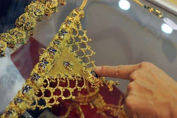 In the overseas markets gold traded a shade higher by 0.05% to $1,319 an ounce in New York in Tuesday's trade. Photo: AFP