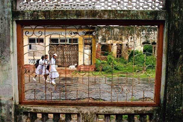 Children walk past a derelict building, a legacy of years of civil war, in Jaffna. Photo: Luis Ascui/Getty Images