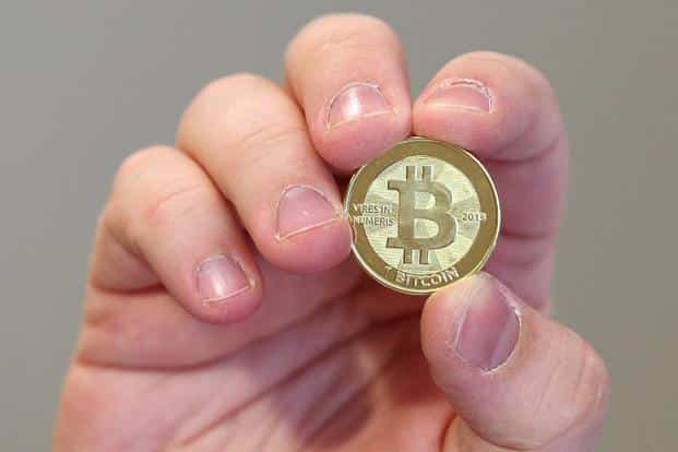 The company calls the promotion an experiment to find how many people would go for Bitcoins against a mobile recharge one-third of its value. Photo: AFP