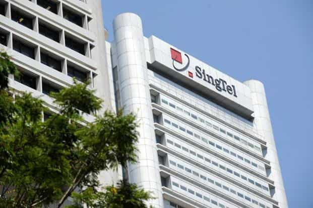 The currency effects meant that SingTel's profit fell 2% even after excluding one-time items, the company said in a presentation. Photo: AFP