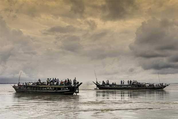 Traditional ferry boats cross the river Brahmaputra between Majuli island and Jorhat in Assam. Photo: Daniel J. Rao/Shutterstock