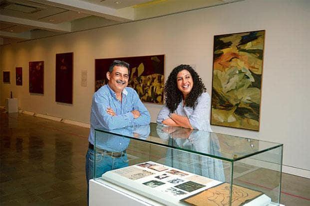 Dadiba Pundole and Shireen Gandhy at the Jehangir Nicholson Gallery; the untitled Ram Kumar hangs to Gandhy's left. Photo: Abhijit Bhatlekar/Mint